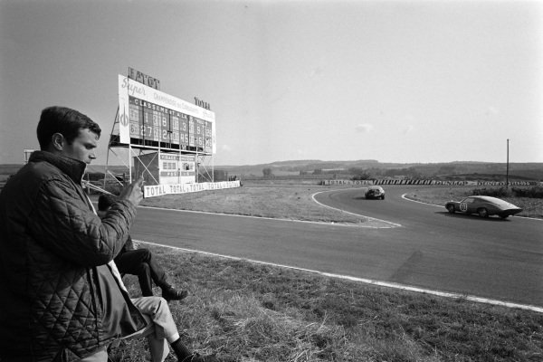 Timekeeping trackside as Robert Bouharde / Pierre Monneret, Automobiles Alpine, Alpine A110 Renault passes.