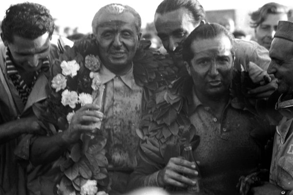 1948 British Grand Prix. Silverstone, Great Britain. 2 October 1948. Luigi Villoresi and Alberto Ascari (both Maserati 4CLT/48), after finishing in 1st and 2nd positions respectively. World - LAT Photographic