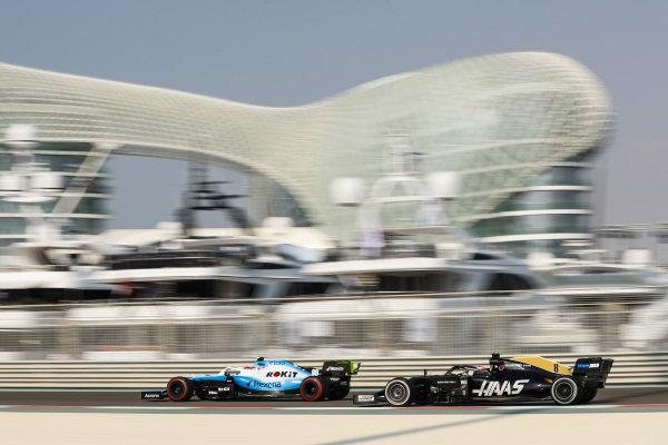 Robert Kubica, Williams FW42, leads Romain Grosjean, Haas VF-19