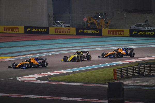 Lando Norris, McLaren MCL34, leads Nico Hulkenberg, Renault R.S. 19 and Carlos Sainz Jr., McLaren MCL34
