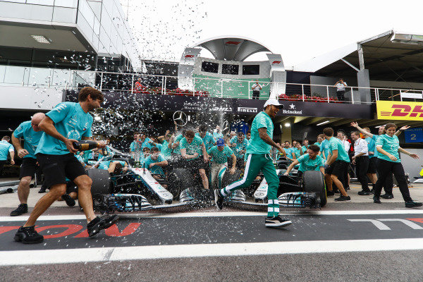The Mercedes team, including Toto Wolff, Executive Director (Business), Mercedes AMG, Lewis Hamilton, Mercedes AMG F1, and Valtteri Bottas, Mercedes AMG F1, celebrate winning the constructors' world championship.