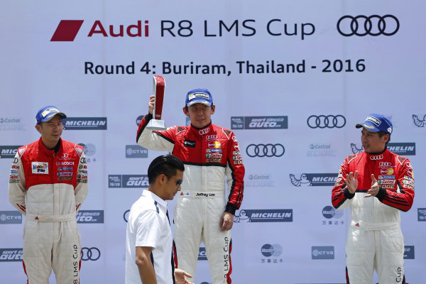 Alex Au (HKG) Phoenix Racing Asia, Jeffrey Lee (TPE) Team Audi Volkswagen Taiwan and Bhurit Bhirombhakdi (THA) Absolute Racing celebrates on the podium with the trophy at Audi R8 LMS Cup, Rd3 and Rd4, Buriram International, Circuit, Buriram, Thailand, 22-24 July 2016.