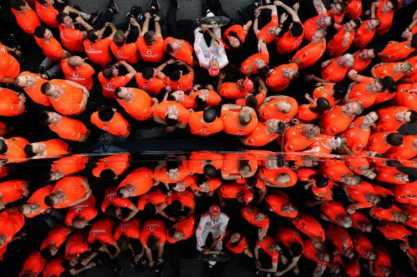 Race winner Jenson Button (GBR) McLaren, celebrates with the McLaren team. Formula One World Championship, Rd12, Belgian Grand Prix, Race, Spa-Francorchamps, Belgium, Sunday 2 September 2012. BEST IMAGE
