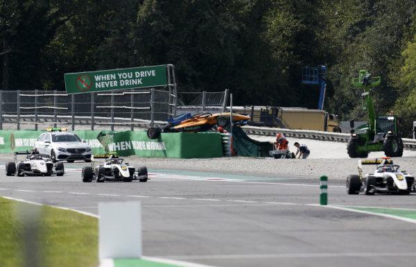 Max Fewtrell (GBR) ART Grand Prix and Raoul Hyman (GBR) Sauber Junior Team by Charouz pass the crash scene of Alexander Peroni (AUS) Campos Racing