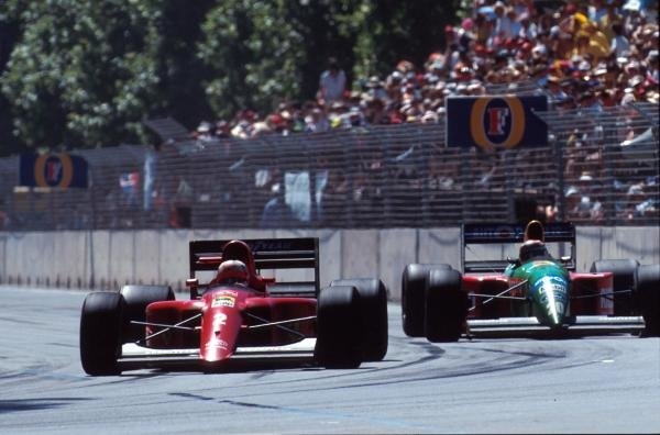 The Ferrari of Nigel Mansell leads the Benetton of race winner Nelson Piquet