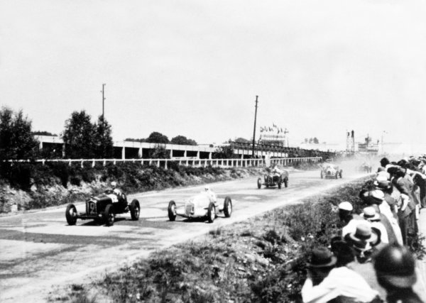 """1934 French Grand Prix Montlhery, France. 1 July 1934 Louis Chiron, Alfa Romeo Tipo-B """"P3"""", 1st position, leads Rudolf Caracciola, Mercedes-Benz W25A, retired, and Achille Varzi, Alfa Romeo Tipo-B """"P3"""", 2nd position, at the start, action World Copyright: Robert Fellowes/LAT PhotographicRef: 34FRA03"""