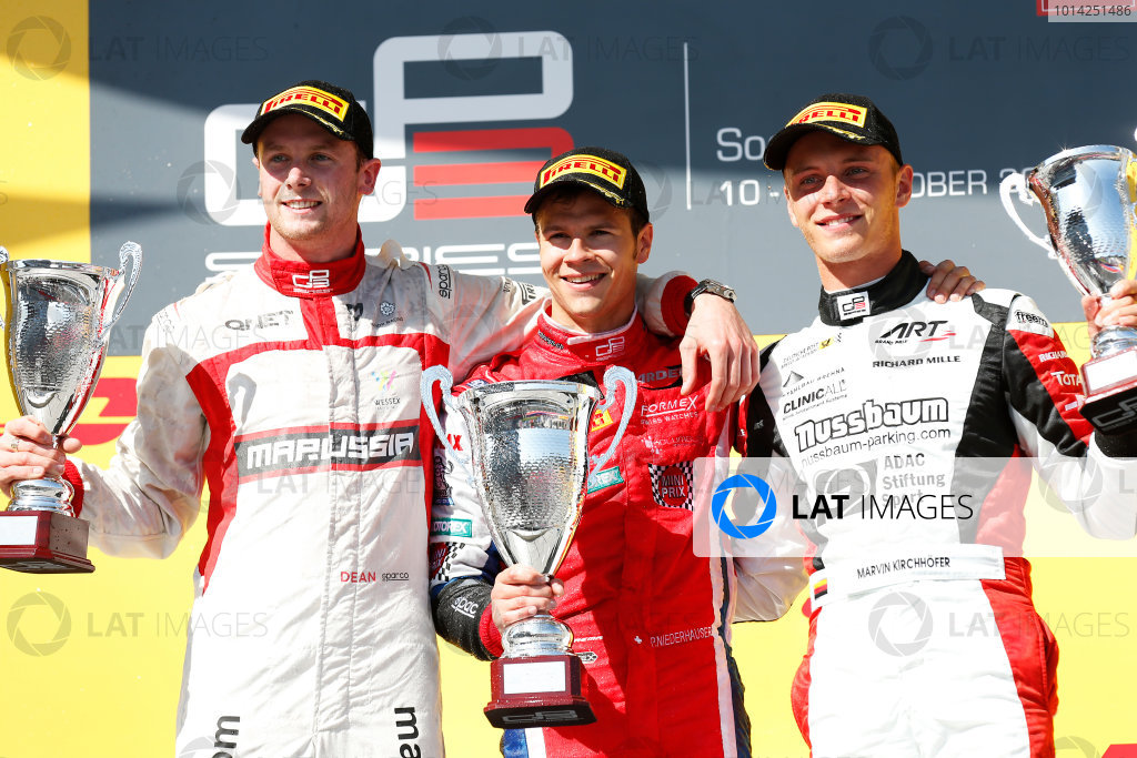 2014 GP3 Series. Round 8.   Sochi Autodrom, Sochi, Russia. Sunday Race 2 Sunday 12 October 2014. Dean Stoneman (GBR, Marussia Manor Racing), Patric Niederhauser (SUI, Arden International) and Marvin Kirchhofer (GER, ART Grand Prix) celebrate on the podium. Photo: Alastair Staley/GP3 Series Media Service. ref: Digital Image _79P5840