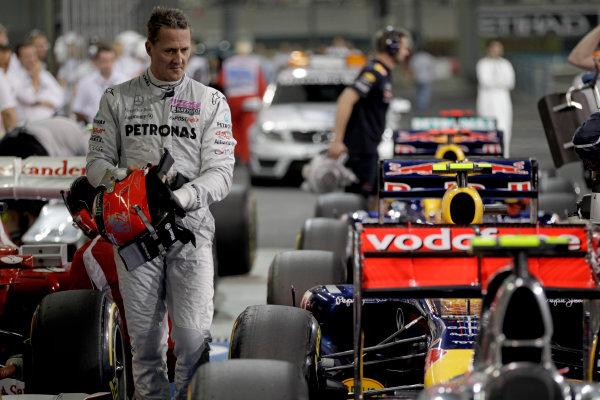 Yas Marina Circuit, Abu Dhabi, United Arab Emirates12th November 2011.Michael Schumacher, Mercedes GP W02, arrives in Parc Ferme. Portrait. Helmets. World Copyright:Glenn Dunbar/LAT Photographic ref: Digital Image _G7C4571