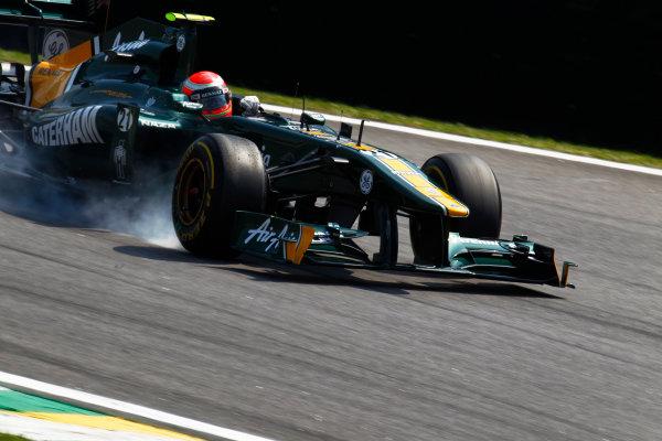 Interlagos, Sao Paulo, Brazil. 25th November 2011. Jarno Trulli, Lotus T128 Renault, locks up under braking. Action.  World Copyright:Steven Tee/LAT Photographic ref: Digital Image _A8C7880