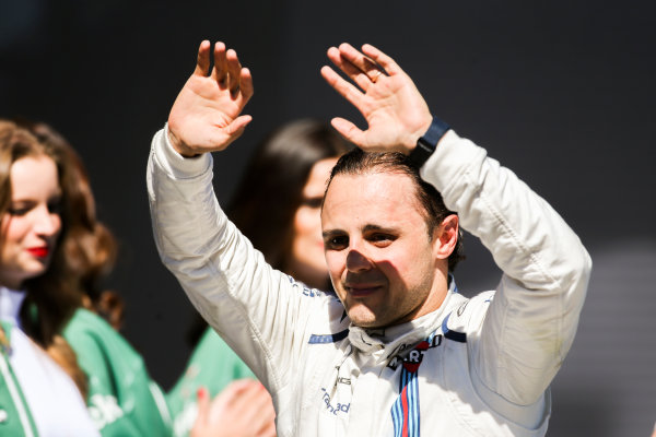 Interlagos, Sao Paulo, Brazil. Sunday 12 November 2017. Felipe Massa, Williams Martini Racing, waves from the podium whilst celebrating after his final home Grand Prix. World Copyright: Charles Coates/LAT Images  ref: Digital Image AN7T7670