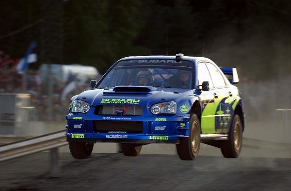 Petter Solberg (NOR) jumps his Subaru Impreza WRC 2003.FIA World Rally Championship, Rd9, Neste Rally Finland, Jyvaskyla, Finland. Day 2, 9 August 2003.DIGITAL IMAGE