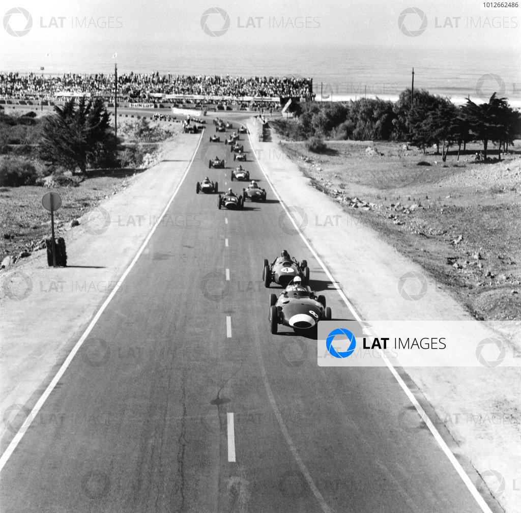 Ain-Diab, Casablanca, Morocco. 17th - 19th October 1958.Stirling Moss (Vanwall VW5) leads Phil Hill (Ferrari Dino 246) at the start of the race. They finished in 1st and 3rd positions respectively, action.World Copyright: LAT Photographic.