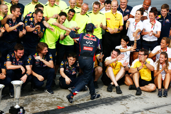 Hungaroring, Budapest, Hungary. Sunday 27 July 2014. Daniel Ricciardo, Red Bull Racing, 1st Position, and the Red Bull team celebrate victory. World Copyright: Andy Hone/LAT Photographic. ref: Digital Image _ONY2846