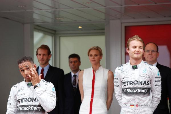 Monte Carlo, Monaco. Sunday 25 May 2014. Lewis Hamilton, Mercedes AMG, 2nd Position, and Nico Rosberg, Mercedes AMG, 1st Position, on the podium. World Copyright: Charles Coates/LAT Photographic. ref: Digital Image _N7T9857