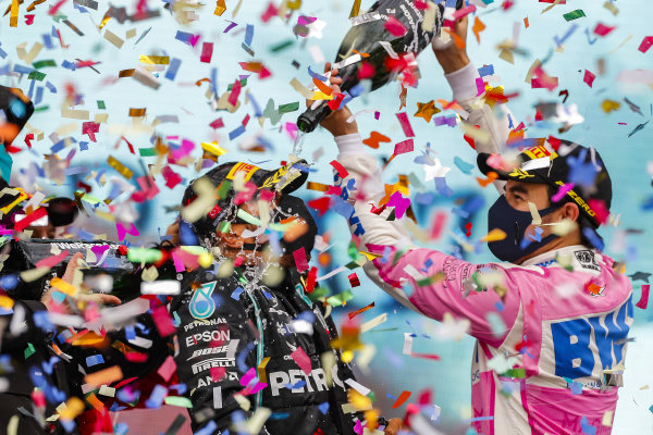 Sergio Perez, Racing Point, 2nd position, pours Champagne over Lewis Hamilton, Mercedes-AMG Petronas F1, 1st position, on the podium