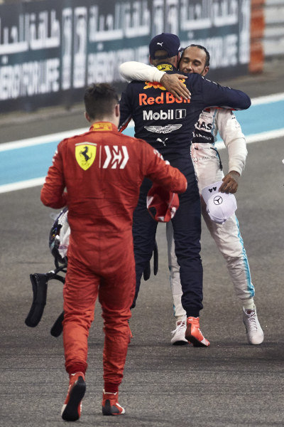 Max Verstappen, Red Bull Racing, 2nd position, congratulates Lewis Hamilton, Mercedes AMG F1, 1st position, as Charles Leclerc, Ferrari, 3rd position, heads over