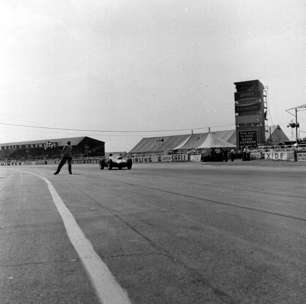 1958 British Grand Prix. Silverstone, England. 17-19 July 1958. Peter Collins (Ferrari Dino 246) wins his home Grand Prix. Ref-2208. World Copyright - LAT Photographic