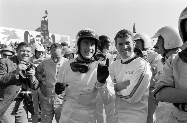 Jackie Stewart and Ronnie Bucknum are among the drivers at the race briefing.