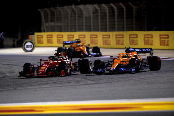 Charles Leclerc, Ferrari SF21, battles with Lando Norris, McLaren MCL35M, ahead of Daniel Ricciardo, McLaren MCL35M