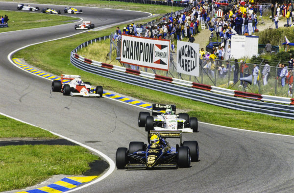 Ayrton Senna, Lotus 97T Renault, leads Teo Fabi, Toleman TG185 Hart, and Alain Prost, McLaren MP4-2B TAG.