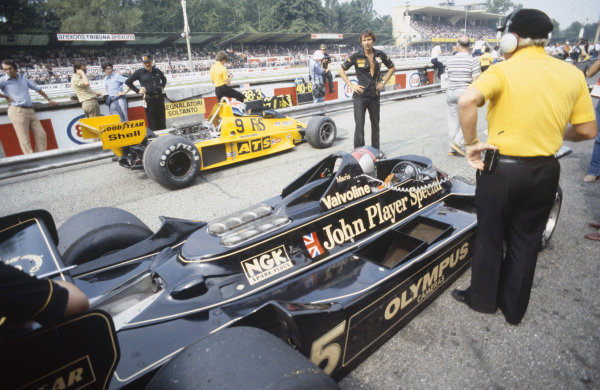 Mario Andretti, Lotus 79 Ford sits in the pit lane as Michael Bleekemolen, ATS HS1 Ford heads out on track.