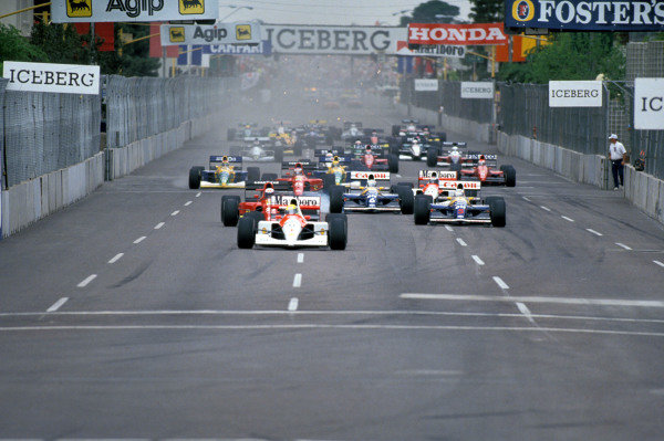 Ayrton Senna, McLaren MP4-6 Honda, leads Alain Prost, Ferrari 642, Nigel Mansell, Williams FW14 Renault, and Riccardo Patrese, Williams FW14 Renault, at the start.