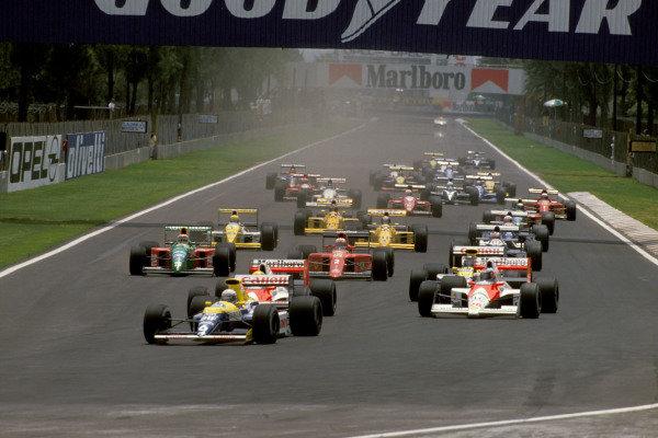 Riccardo Patrese, Williams FW13B Renault, leads Ayrton Senna, McLaren MP4-5B Honda, and Gerhard Berger, McLaren MP4-5B Honda, at the start of the race.