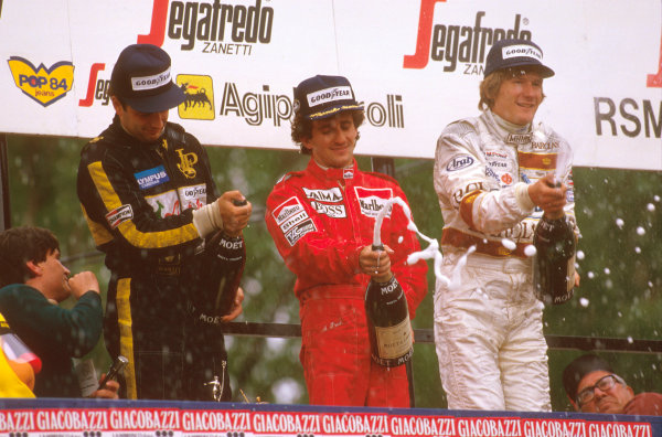 Imola, Italy. 3-5 May 1985. Alain Prost (McLaren TAG Porsche) 1st position but later disqualified due to the car being under weight at the finish, Elio de Angelis (Team Lotus) 1st position and Thierry Boutsen (Arrows BMW) 2nd position, on the podium. Ref-85 SM 02. World Copyright - LAT Photographic