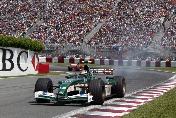 2002 Canadian Grand Prix - RaceMontreal, Canada. 9th June 2002Eddie Irvine (Jaguar R3-Cosworth) trailing smoke.World Copyright: Steve Etherington/LATref: Digital Image Only