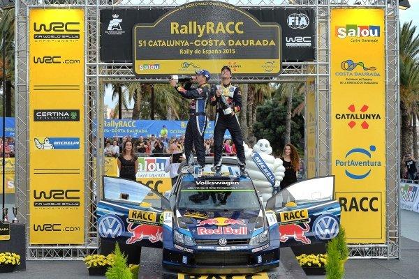 Race winner Andreas Mikkelsen (NOR) / Ola Floene (NOR) Volkswagen Polo R WRC celebrate on the podium at FIA World Rally Championship, Rd12, RAAC Rally de Espana, Day Three, Costa Daurada, Catalunya, Spain, 25 October 2015.