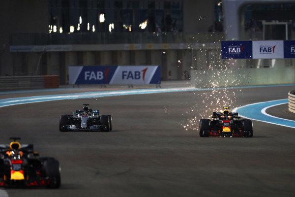 Daniel Ricciardo, Red Bull Racing RB14, leadsMax Verstappen, Red Bull Racing RB14, and Lewis Hamilton, Mercedes AMG F1 W09 EQ Power+
