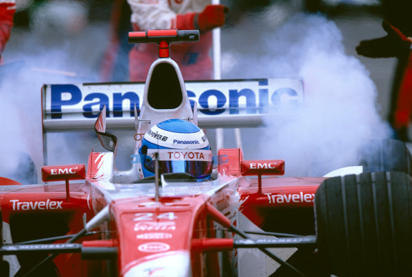 2002 Belgian Grand Prix.Spa-Francorchamps, Belgium. 30/8-1/9 2002.Mika Salo (Toyota TF102) smokes up his rears as he exits after a pitstop.Ref-02 BEL 24.World Copyright - Tee/LAT Photographic