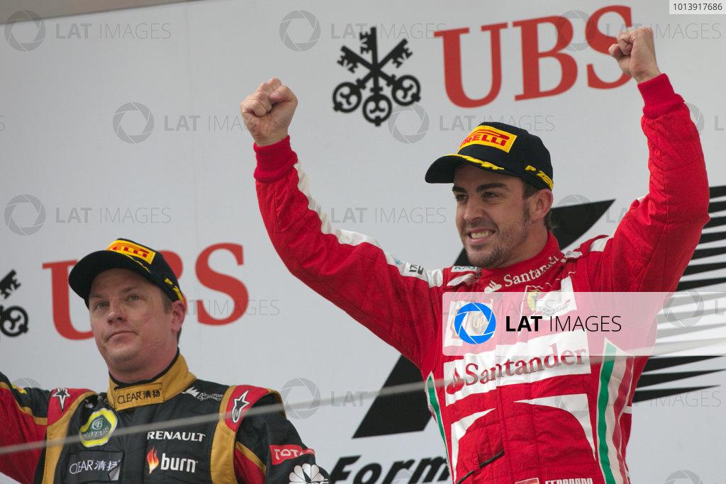 Shanghai International Circuit, Shanghai, China Sunday 14th April 2013 Fernando Alonso, Ferrari, 1st position, celebrates on the podium. World Copyright: Andy Hone/LAT Photographic ref: Digital Image HONZ7818