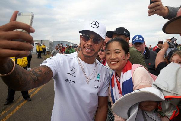 Silverstone, Northamptonshire, UK.  Sunday 16 July 2017. Lewis Hamilton, Mercedes AMG, signs autographs for fans. World Copyright: Steve Etherington/LAT Images  ref: Digital Image SNE10701