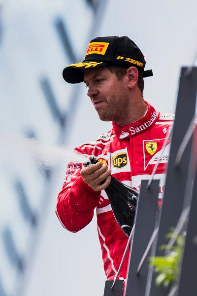 Red Bull Ring, Spielberg, Austria. Sunday 9 July 2017. Sebastian Vettel, Ferrari, 2nd Position, sprays Champagne on the podium. World Copyright: Zak Mauger/LAT Images ref: Digital Image _56I5169