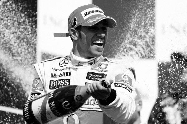 Race winner Lewis Hamilton (GBR) McLaren celebrates on the podium. Formula One World Championship, Rd 10, Hungarian Grand Prix, Race, Budapest, Hungary, Sunday 26 July 2009.