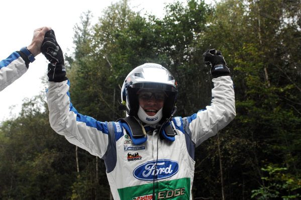 Jari-Matti Latvala (FIN) celebrates victory at the end of stage 19, the power stage. FIA World Rally Championship, Rd10, Wales Rally GB, Day Three, Cardiff, Wales, 16 September 2012.
