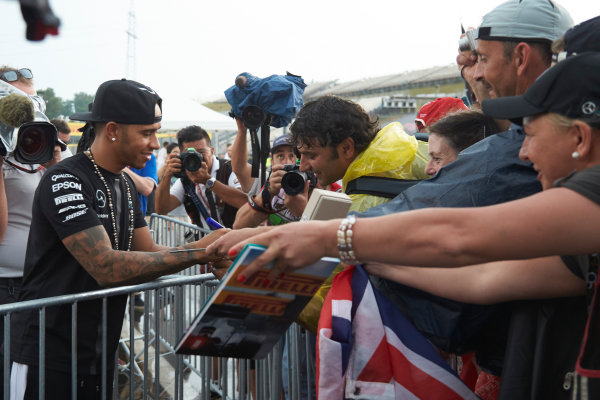 Hungaroring, Budapest, Hungary. Thursday 23 July 2015. Lewis Hamilton, Mercedes AMG, signs autographs for fans. World Copyright: Steve Etherington/LAT Photographic ref: Digital Image SNE11164