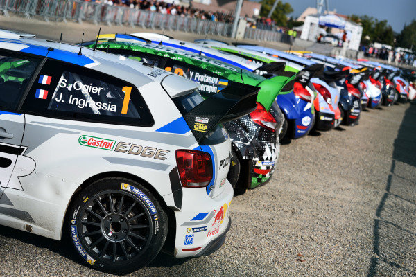 The car of Sebastien Ogier (FRA) Volkswagen Polo R WRC and others line up in service. FIA World Rally Championship, Rd11, Rallye De France, Strasbourg, Alsace, France. Day Two, Saturday 4 October 2014.