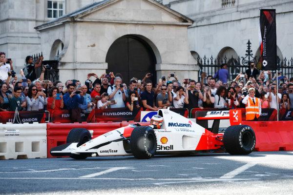 London, United Kingdom.  Wednesday 12 July 2017. Stoffel Vandoorne, McLaren, demonstrates a 1991 McLaren MP4/6 that was raced by Ayrton Senna. World Copyright: Glenn Dunbar/LAT Images  ref: Digital Image _X4I0876