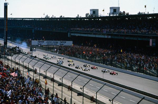 Indianapolis, Indiana, USA.28-30 September 2001.Michael Schumacher (Ferrari F2001) leads the field away at the start, followed by Juan-Pablo Montoya, Ralf Schumacher (both Williams FW23 BMW's), Rubens Barrichello (Ferrari F2001), Mika Hakkki nen, David Coulthard (both McLaren MP4/16 Mercedes), Nick Heidfeld (Sauber C20 Petronas) and Jarno Trulli (Jordan EJ11 Honda).World Copyright: Steven Tee/LAT PhotographicRef: 01 USA 02