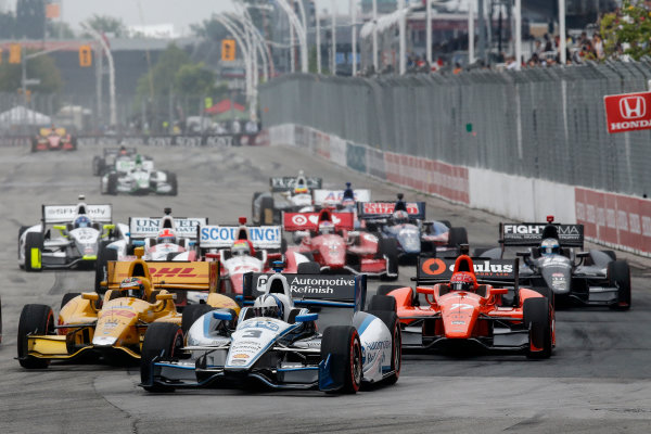 20 July, 2014, Toronto, Ontario, Canada Helio Castroneves in the middle of a pack of cars at the start ©2014, Michael L. Levitt LAT Photo USA