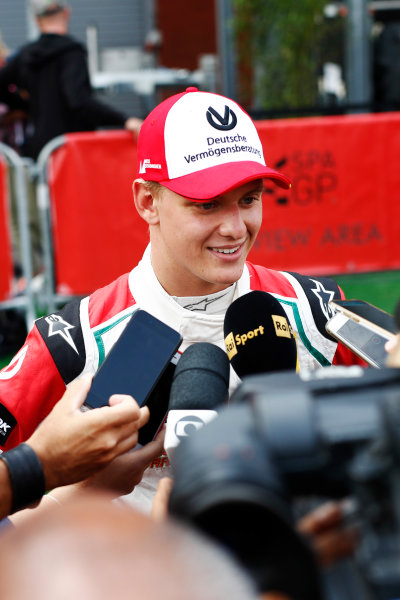 Spa Francorchamps, Belgium.  Sunday 27 August 2017. Mick Schumacher is interviewed after driving his father, Michael's, 1994 Benetton Ford B194. World Copyright: Glenn Dunbar/LAT Images  ref: Digital Image _31I6735