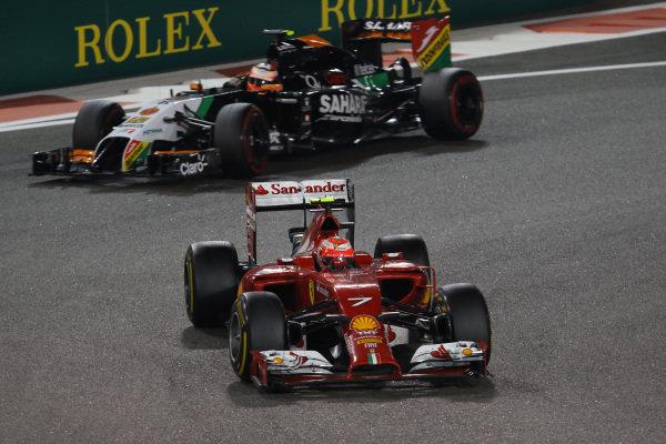 Kimi Raikkonen (FIN) Ferrari F14 T leads Nico Hulkenberg (GER) Force India VJM07.Formula One World Championship, Rd19, Abu Dhabi Grand Prix, Race, Yas Marina Circuit, Abu Dhabi, UAE, Sunday 23 November 2014.