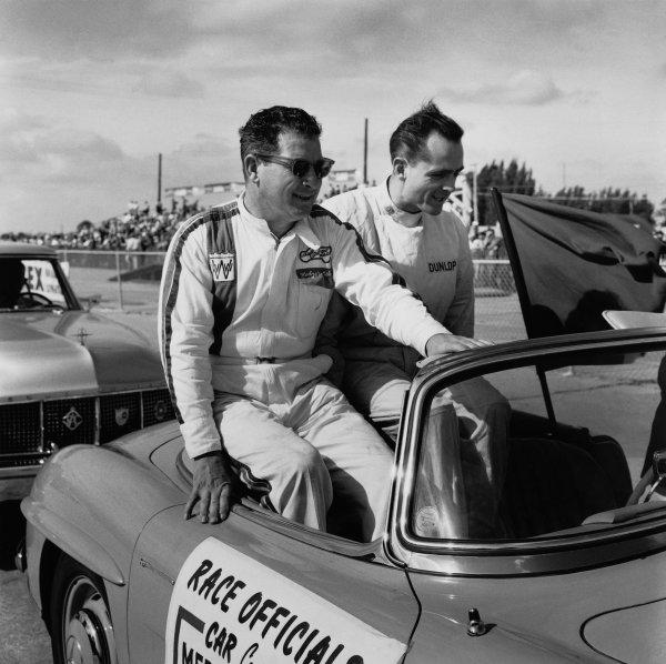 Sebring, Florida, USA. 10 - 12 December 1959.Rodger Ward (Kurtis-Kraft-Offenhauser), retired, with Phil Hill (Ferrari Dino 246), retired, on the drivers parade, portrait. World Copyright: LAT Photographic.Ref:  5505.