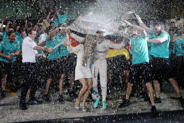 Yas Marina Circuit, Abu Dhabi, United Arab Emirates. Sunday 27 November 2016. New World Champion Nico Rosberg, Mercedes AMG, 2nd Position, celebrates with his team and family. World Copyright: Charles Coates/LAT Photographic ref: Digital Image DJ5R9818