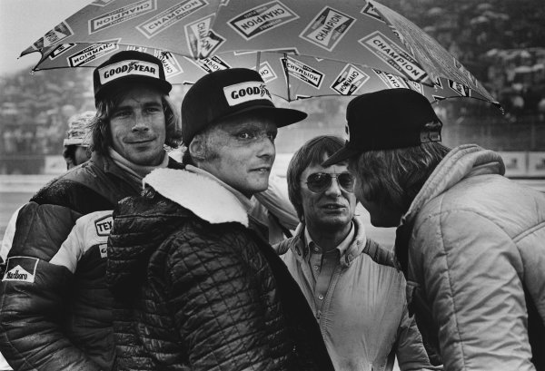 Fuji, Japan. 22nd - 24th October 1976. James Hunt (McLaren M23-Ford), 3rd position with Niki Lauda (Ferrari 312T2), retired, Ronnie Peterson (March 761-Ford), retired and Bernie Ecclestone in the pit lane before the start of the race, portrait.   World Copyright: LAT Photographic Ref: 9256 - 25A.