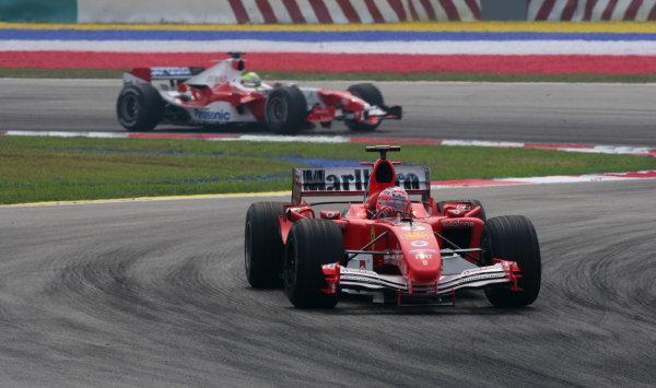 2005 Malaysian Grand Prix - Sunday Race, Sepang, Kuala Lumpur. Malaysia. 20th March 2005 Rubens Barrichello, Ferrari F2004M, action.World Copyright: Steve Etherington/LAT Photographic ref: 48mb Hi Res Digital Image Only