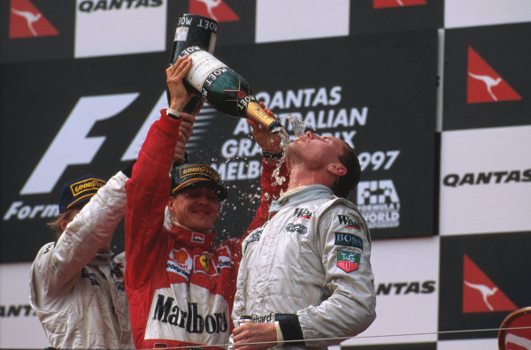 Albert Park, Melbourne, Australia.7-9 March 1997.David Coulthard (McLaren Mercedes) 1st position, Michael Schumacher (Ferrari) 2nd position and Mika Hakkinen (McLaren Mercedes) 3rd position celebtrate on the podium.Ref-97 AUS 04.World Copyright - LAT Photographic