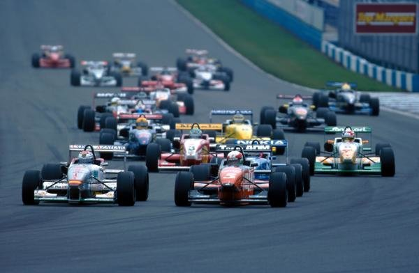 Marc Gene (ESP) (left) was the 1998 champion with six wins and three pole positions. Open Fortuna Nissan Championship, Donington Park, England,  September 1998.
